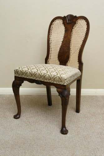 A pair of Queen Anne style walnut chairs