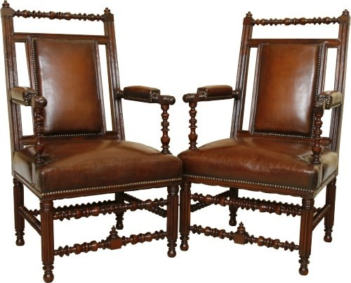 A stunning pair of 19th century open arm chairs