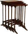 An unusual set of four George III graduating mahogany tables